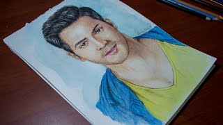 Drawing varun dhawan with camlin watercolour and faber castell classic colour pencil. i completed this in 4hr. m trying to improve my art skill ...