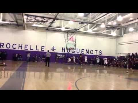 New Rochelle's Joe Clarke scores and the Huguenots come up with a stop on the other end. Mount Vernon defeated New Rochelle, 74-56.