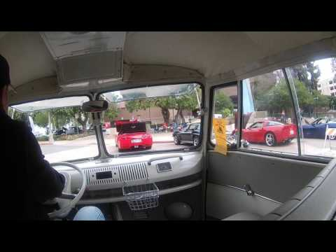 66 vw microbus driving through the show and go riverside
