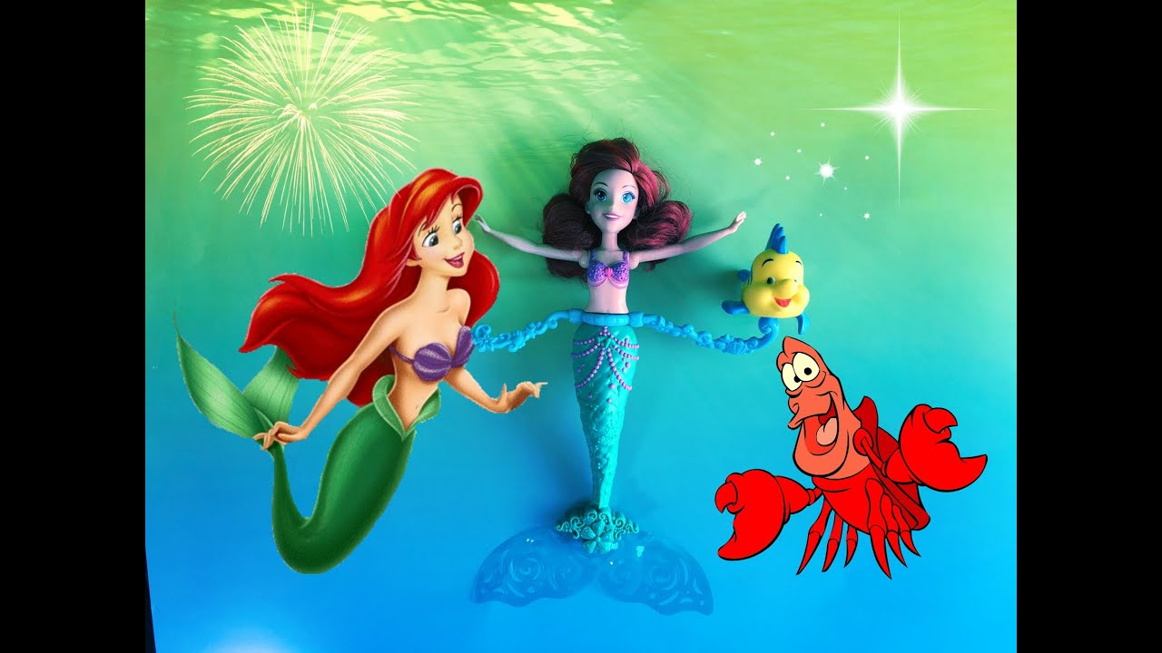 the little mermaid ariel toys sebastian and flounder swim in the