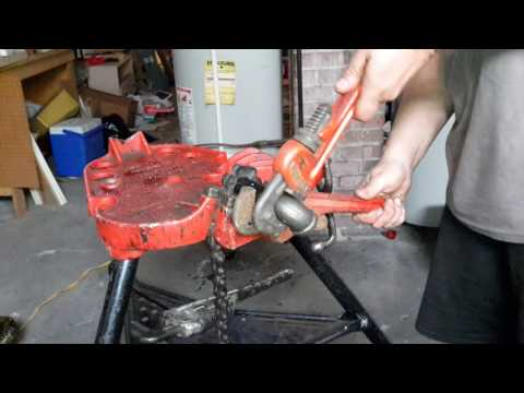 Diy gas pipe applying pipe dope and tighten fitting
