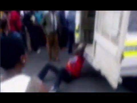 Police Drag Man to Death (Disturbing Video)