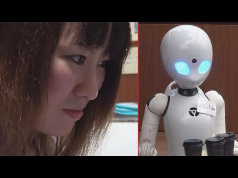 Woman In Wheelchair Uses Robot Waiter To Serve Food To Customers