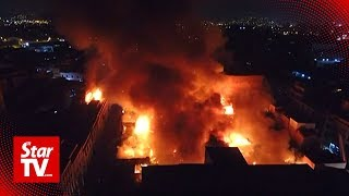 Massive fire engulfs warehouse in downtown Lima