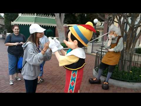 Pinocchio and Shawna playing a hand clapping game at Disneyland on 9-11-11