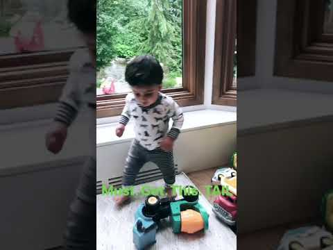 Bengal cat and baby boy chasing tail