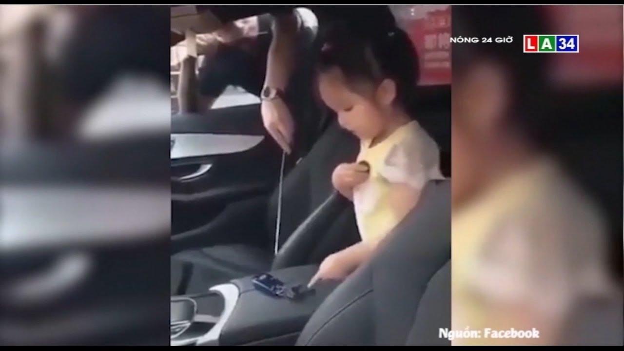 Camera nóng | Con gái ngồi trong ôtô nhặt que cho bố khều chìa khóa | LONG AN TV