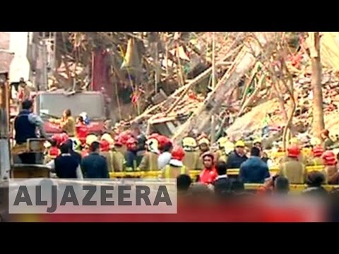 Search for survivors at Tehran collapsed tower