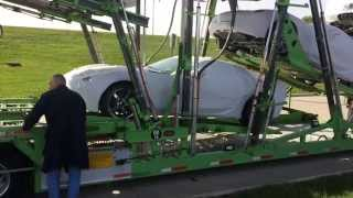 CORVETTE OFF THE TRANSPORT AT OKOBOJI MOTOR COMPANY