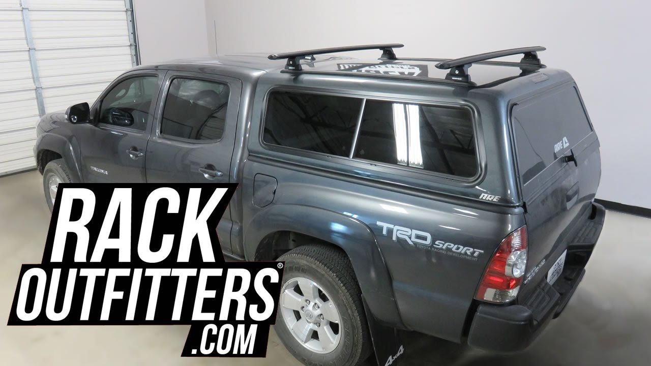 Toyota Tacoma with ARE Camper Shell Topper with Rhino Rack Quick Mount  Vortex Roof Rack Crossbars