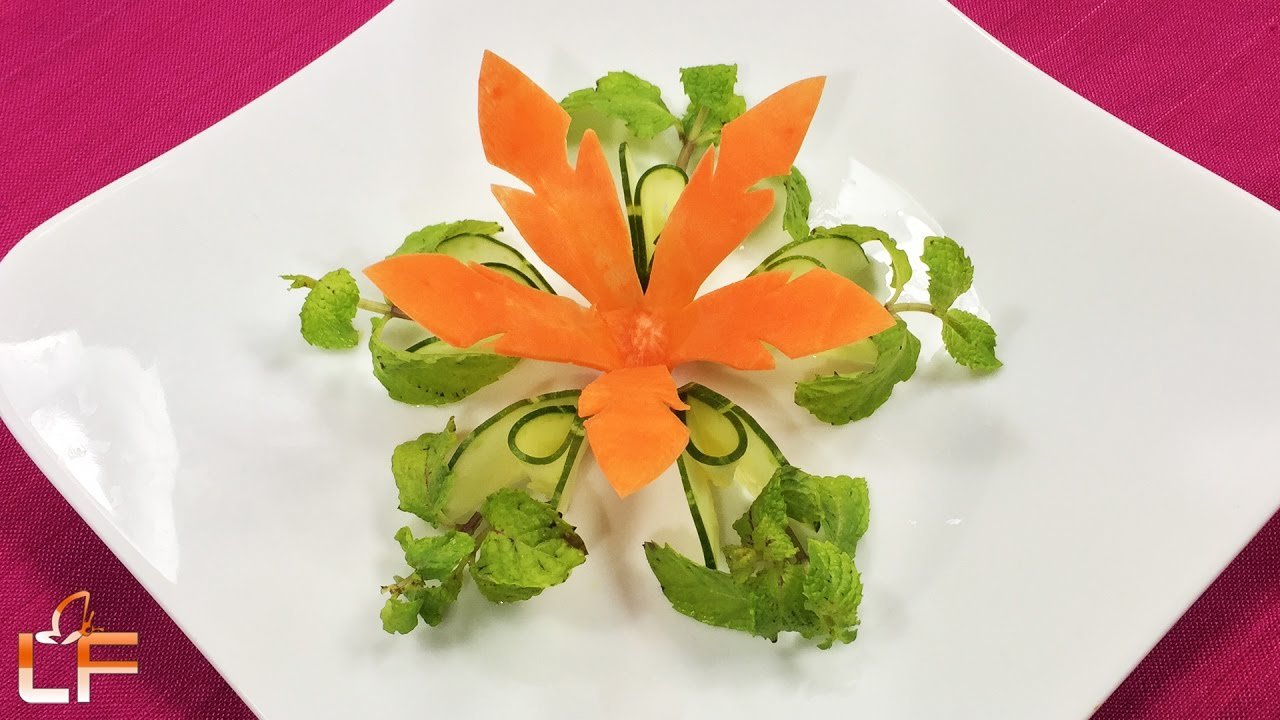 Very beautiful carrot flower carving garnish fruit