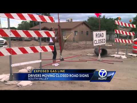 Exposed Gasline: Drivers Moving Road Closed Signs