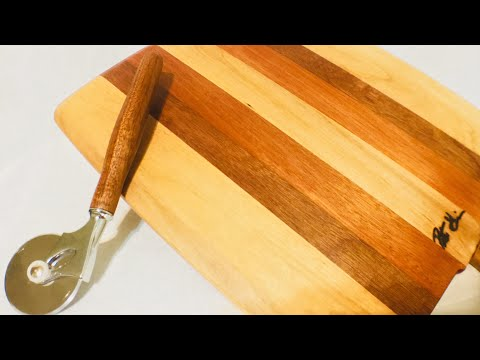 A Pizza Peel With Matching Wood Cutter