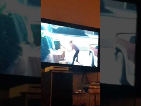 My sister in law in demolition mode in slow motion.