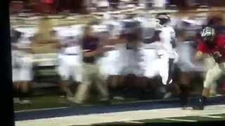Cheerleader gets tackled by football player