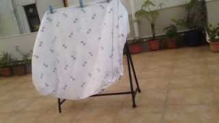 Blanket on our roof on a clothes horse/clothes rack and flapping in the wind