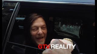 Giving a carton of cigarettes to Norman Reedus