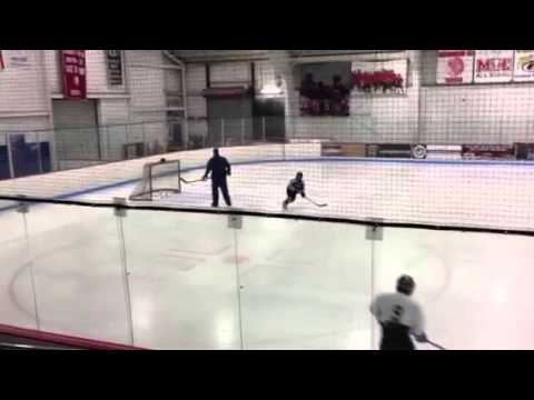 Fwd across ice carrying puck not stck hand then shoot