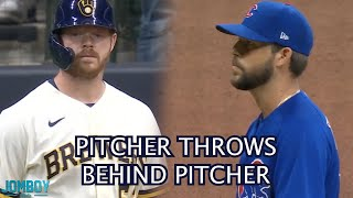 Cubs Pitcher throws behind Brewers Pitcher, a breakdown