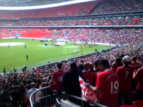 Manchester United fans singing Glory Glory at wembley .