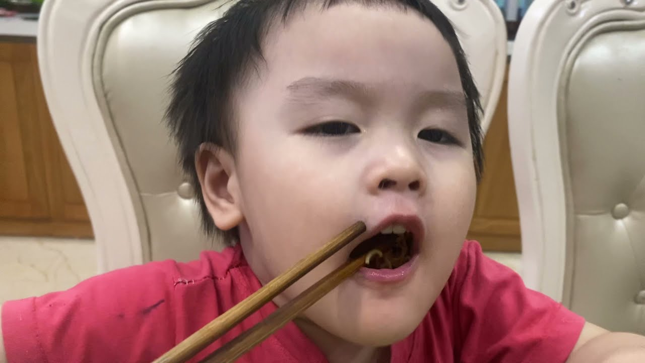 Baby  cute eating noodles with  sister