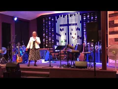 Hna. Rosario Murillo sings at NEW HOPE FAMILY WORSHIP CENTER.