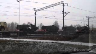 Американская военная техника перевозят на поезде в Украине в зону АТО