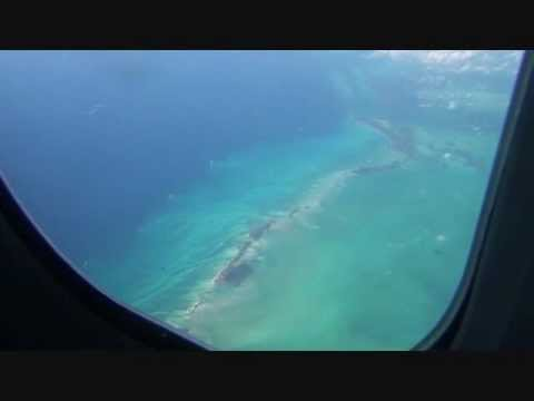 Flying over Cuba and Beautiful Blue Waters of Caribbean Sea