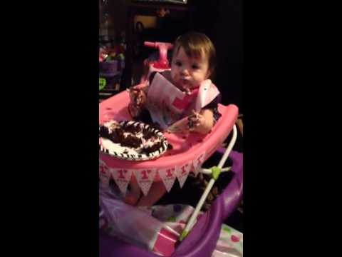 Celina eating her first birthday cake