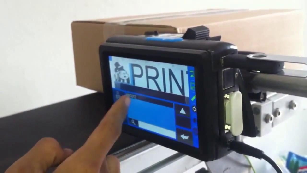 E1高解析噴印機-紙箱條碼噴印-日期序號標示-圖案噴印-QR cord-手動噴印 - YouTube