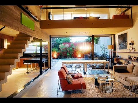 MODERN CONCRETE HOUSE DESIGN WITH TRANSPARENT GROUND INTERIOR