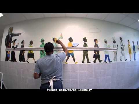 T. Ellis creating student mural at Mainland Preparatory Academy