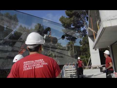 House Schäfer. how to install a large glass window of 900 kg?