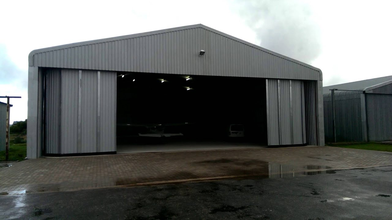 CENTURION A10 Automating Double Sectional Airplane Hangar Doors  sc 1 st  YouTube & CENTURION A10 Automating Double Sectional Airplane Hangar Doors ...
