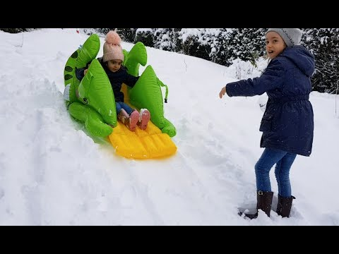 Playing with Snow - Kids Ride on Sleigh