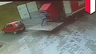 Repeat youtube video Shocking CCTV footage: Polish man CRUSHED by refrigerator while unloading truck