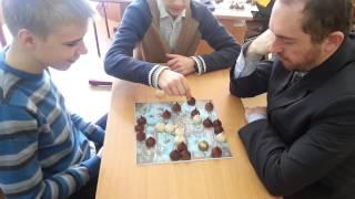 Математики играют в древнеславянскую настольную игру Оберег