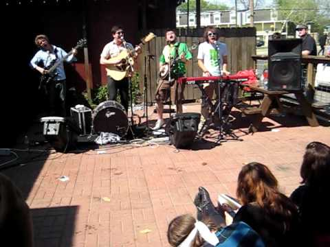 Somewhat unknown in the U.S. at the time, Mumford and Sons plays the back of a Pizza shop in Austin, TX, 2009
