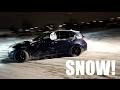 BMW 130i night snow drift