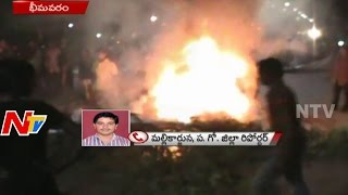 pawan kalyan fans violence in bhimavaram   fans set telugu heroes flexis on fire