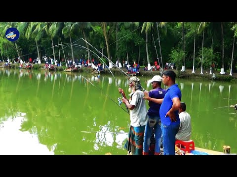 Two Aged Professional Anglers Catching The Big Fish In City Fishing Competition