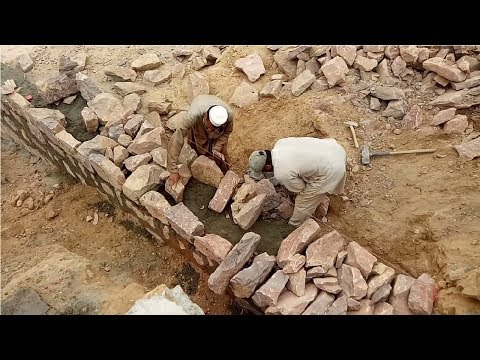 Stone masonry wall construction
