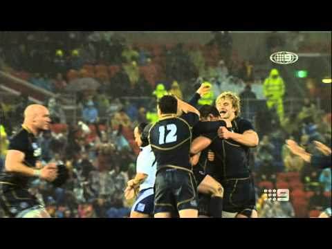 Two Rugby players bang heads while celebrating