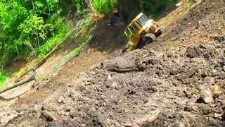 D5 dozer sliding down steep mountian