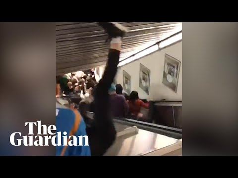 Escalator speeds up and collapses in Rome, injuring football fans