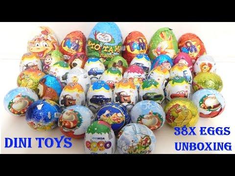 Мега распаковка киндеров сюрприз 38 шт - видео распаковка шоколадных яиц на русском языке