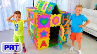 Vlad e Nikita jogam e constroem o Playhouse colorido