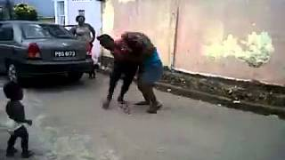 Repeat youtube video 2 Trini Hood Rats fighting almost trample Child