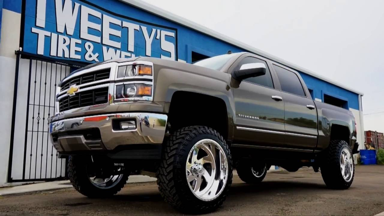 2015 Chevy Silverado with a 9 inch lift kit with 22 by 14 ...