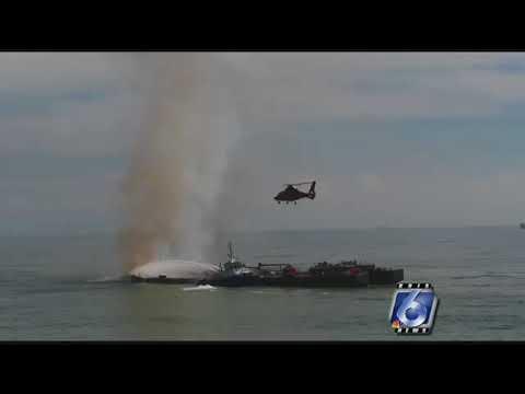 Coast Guard examines response to barge explosion